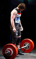10 MAY 2014 - COVENTRY, GBR - Jack Oliver from the Paul Furness School of Weightlifting prepares to lift during the men's 77kg A category round at the British 2014 Senior Weightlifting Championships and final 2014 Commonwealth Games qualifying event round at the Ricoh Arena in Coventry, Great Britain. Oliver's combined total for the event of 312kg, 32kg over the qualifying standard, makes him eligible for selection for the England team for the Commonwealth Games in Glasgow (PHOTO COPYRIGHT © 2014 NIGEL FARROW, ALL RIGHTS RESERVED)