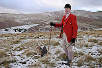 Askham, Cumbria, England, 27/12/2003..The Ullswater Hunt fox-hunting in what may be the last legal hunting season in the UK, as Parliament moves to ban hunting with dogs. The Ullswater hunt on foot in the Cumbrian Fells led by Huntsman John Harrison.
