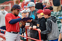 New Hampshire Fisher Cats Juan Kelly (25) signs autographs for fans before a game against the Erie SeaWolves on June 20, 2018 at UPMC Park in Erie, Pennsylvania.  New Hampshire defeated Erie 10-9.  (Mike Janes/Four Seam Images)