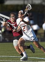 Boston College midfielder Caroline Margolis (21) on the attack as Harvard University defender/midfielder Lauren Tomkinson (3) defends.