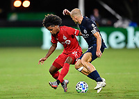 LAKE BUENA VISTA, FL - JULY 26: Jayden Nelson of Toronto FC is pressured by Alexander Ring of New York City FC during a game between New York City FC and Toronto FC at ESPN Wide World of Sports on July 26, 2020 in Lake Buena Vista, Florida.