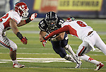 Fresno State's L.J. Jones (6) and Jeremiah Toma (32) tackle Nevada's Nick Hale (32) during the second half of an NCAA college football game in Reno, Nev., on Saturday, Nov. 10, 2012. Fresno State defeated Nevada 52-36. (AP Photo/Cathleen Allison)