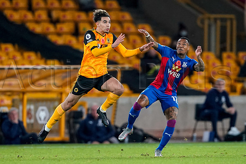 30th October 2020; Molineux Stadium, Wolverhampton, West Midlands, England; English Premier League Football, Wolverhampton Wanderers versus Crystal Palace; Rayan Aït-Nouri of Wolverhampton Wanderers and Nathaniel Clyne of Crystal Palace get ready to compete in the air for the ball