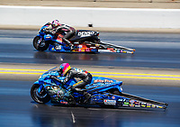 Jul 30, 2017; Sonoma, CA, USA; NHRA pro stock motorcycle rider L.E. Tonglet (near) races alongside Angie Smith during the Sonoma Nationals at Sonoma Raceway. Mandatory Credit: Mark J. Rebilas-USA TODAY Sports