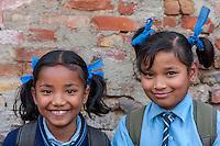 Bhaktapur, Nepal.  Two Schoolgirls in Uniform.