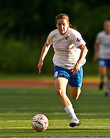 Midfielder Heather O'Reilly (9), playing in her debut with the Boston Breakers dribbles with the ball across center field.  The Boston Breakers beat the New York Fury 2-0 at Dilboy Stadium.