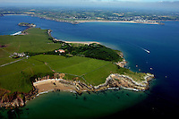 Pictured: Aerial view of Caldey Island off the Pembrokeshire coast, Wales, UK. Circa 2006 <br /> Re: A small island off the Welsh coast known for its order of perfume-making monks and sense of tranquility has recorded its first crime in recent history.<br /> Police were called to Caldey Island which has apopulation of 40, off Tenby in Pembrokeshire, west Wales after an incident at the chocolate factory.<br /> The officers were taken on an RNLI lifeboat to the island, 2 miles off the resort of Tenby, to make an arrest.<br /> The crime was revealed when a visitor from Dudley, West Midlands, appeared in Haverfordwest magistrates court and admitted assault. The man was visiting the island when he struck his  7 year old son during a visit to the chocolate factory, where handmade treats are produced by monks.