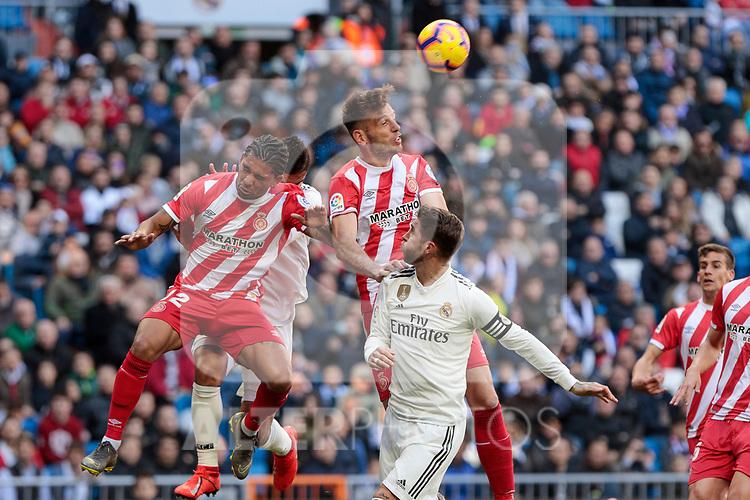 Real Madrid's Sergio Ramos and Girona FC's Douglas Luiz during La Liga match between Real Madrid and Girona FC at Santiago Bernabeu Stadium in Madrid, Spain. February 17, 2019. (ALTERPHOTOS/A. Perez Meca)