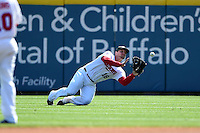 Buffalo Bisons outfielder Brad Glenn (18) makes a diving catch during a game against the Lehigh Valley IronPigs on May 17, 2014 at Coca-Cola Field in Buffalo, New  York.  Lehigh Valley defeated Buffalo 2-1  (Mike Janes/Four Seam Images)