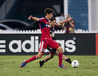 Chris Korb (22) of D.C. United fights for the ball with Alvaro Fernandez (4) of the Chicago Fire at RFK Stadium in Washington, DC.  D.C. United defeated the Chicago Fire, 4-2.