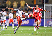 Chicago midfielder Cuauhtemoc Blanco (10) tries to win a ball against Toronto FC defender Marvell Wynne (16).  Chicago Fire defeated Toronto FC by the score of 2-1 at Toyota Park stadium, in Bridgeview, Illinois on Saturday, July 12, 2008.