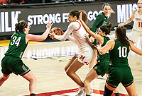 COLLEGE PARK, MD - DECEMBER 8: Shakira Austin #1 of Maryland holds onto the ball in front of the Loyola defense during a game between Loyola University and University of Maryland at Xfinity Center on December 8, 2019 in College Park, Maryland.