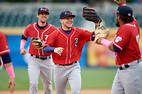 New Hampshire Fisher Cats right fielder Andrew Guillotte (1) is congratulated by Juan Kelly (25) as he runs off the field followed by Cavan Biggio (6) during the first game of a doubleheader against the Harrisburg Senators on May 13, 2018 at FNB Field in Harrisburg, Pennsylvania.  New Hampshire defeated Harrisburg 6-1.  (Mike Janes/Four Seam Images)