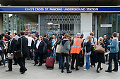 Rush hour commuters queue outside Kings Cross underground station during a one day strike by RMT union members over proposed job cuts.