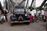 Danang, February 1988. Crossing the Perfume River and old French built bridge link the two sides of the city. There is an endless traffic on that bridge.