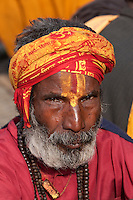Pashupatinath, Nepal.  Sadhu (Holy Man) at Nepal's Holiest Hindu Temple.  The trident on his forehead marks him as a devotee of Shiva.