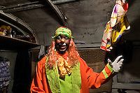 Walter, a Colombian clown, in his costume and makeup before a performance at the Circo Anny, a family run circus wandering the Amazon region of Ecuador, 4 July 2010. The Circo Anny circus belongs to the old-fashioned traveling circuses with a usual mixture of acrobat, clown and comic acts. Due to the general loss of popularity caused by modern forms of entertainment such as movies, TV shows or internet, these small family enterprises balance on the edge of survival. Circuses were pushed away and now they have to set up their shows in more remote villages. The circus art and culture is slowly dying.
