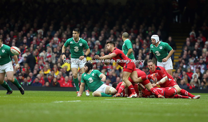 Pictured: Rhys Webb of Wales passes the ball Saturday 14 March 2015<br /> Re: RBS Six Nations, Wales v Ireland at the Millennium Stadium, Cardiff, south Wales, UK.