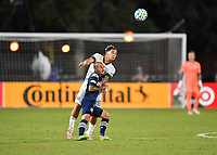 LAKE BUENA VISTA, FL - AUGUST 01: Alexandru Mitrita #22 of New York City FC and Pablo Bonilla #28 of the Portland Timbers challenge for a header during a game between Portland Timbers and New York City FC at ESPN Wide World of Sports on August 01, 2020 in Lake Buena Vista, Florida.