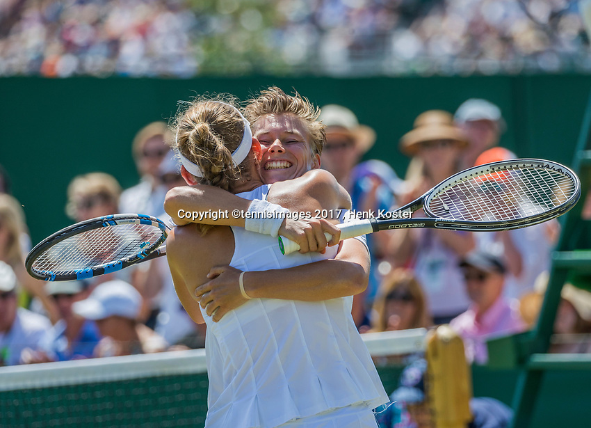London, England, 7 th July, 2017, Tennis,  Wimbledon, Womans doubles: Elise Mertens (BEL) / Demi Schuurs (NED) (R) celebrate their win in the second round.<br /> Photo: Henk Koster/tennisimages.com