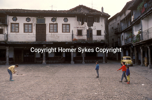 La Alberca Salamanca Spain 1990s. A group of local young boys playing in  Plaza Mayor 1990