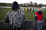 Bacup Borough 4 Holker Old Boys 1, 25/04/2016. Brain Boys West View Stadium, NorthWest Counties League Division One. Spectators watching as the teams shake hands at the Brain Boys West View Stadium before Bacup Borough play Holker Old Boys in a NorthWest Counties League division one fixture. Formed as Bacup in 1879, the club moved into their current home in 1889 and have been known as Bacup Borough since the 1920s, apart from a brief recent spell when they added the name Rossendale to their name. With both teams challenging for play-off places, Bacup Borough won this fixture by 4-1, watched by a crowd of 50. Photo by Colin McPherson.