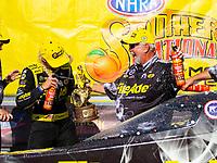 May 6, 2018; Commerce, GA, USA; NHRA top fuel driver Leah Pritchett (left) celebrates with sponsor Ron Thames after winning the Southern Nationals at Atlanta Dragway. Mandatory Credit: Mark J. Rebilas-USA TODAY Sports