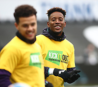20th March 2021; Liberty Stadium, Swansea, Glamorgan, Wales; English Football League Championship Football, Swansea City versus Cardiff City; Jamal Lowe of Swansea City enjoys a joke during warm up wearing a 'Kick It Out' shirt in support of anti-racism in football