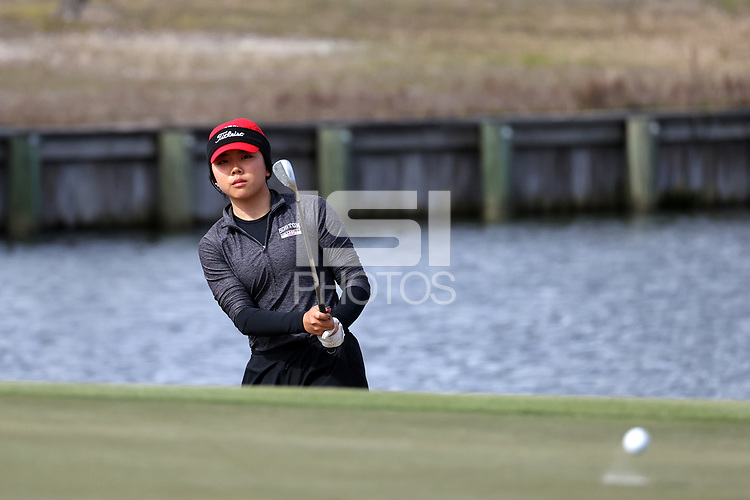 WALLACE, NC - MARCH 09: Kristen Min Ju Kim of Boston University chips onto the 15th green of the River Course at River Landing Country Club on March 09, 2020 in Wallace, North Carolina.