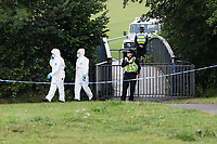 Pictured: Police forensics officers in a footpath near Lower Llansantffraid in Sarn near Bridgend, Wales, UK. Monday 02 August 2021 <br /> Re: South Wales Police can confirm that  three people have been arrested following reports of concerns for a missing 5 year old boy, named as Logan Williamson or Logan Mwangi, in Sarn, Bridgend, and the subsequent finding of the body in the Ogmore River near Pandy Park, Bridgend, Wales, UK.<br /> A 39 year male, 30 year female and 13 year old male, all from the Bridgend area, have been arrested on suspicion of murder and are currently in police custody.  We are not looking for anyone else in relation to this incident.