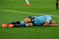 Alvaro Pereira of Uruguay is unconscious