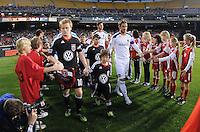 DC United midfielder Dax McCarty (10) with Los Angeles Galaxy midfielder David Beckham getting into the field.    DC United tied  Los Angeles Galaxy 1-1, at RFK Stadium, Saturday April 9, 2011.