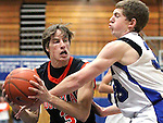 Douglas' Nick Maestretti and Carson's Rafe King battle for the ball during the boys basketball game at Carson High School on Friday, Jan. 27, 2012. Douglas won 54-46..Photo by Cathleen Allison