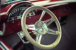 White steering wheel in classic red car