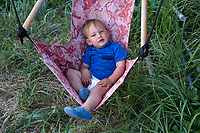 Baby Lawrence on the Bouker's setnet site in the Nushagak River in Bristol Bay in Alaska on July 6, 2019. Lawrence lives at the seasonal fish camp with his parents, grandparents and extended family. (Photo by Karen Ducey)