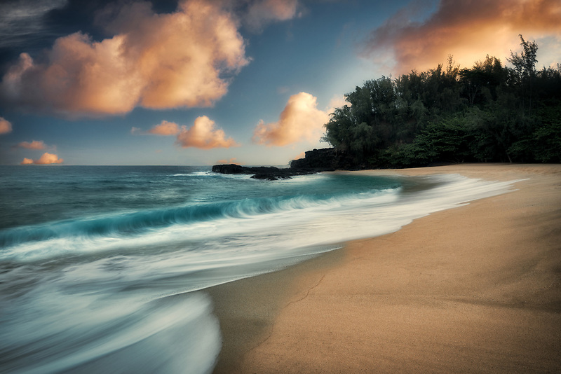 Sunrise and waves at Lumahai Beach. Kauai, Hawaii.