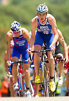 27 MAY 2012 - MADRID, ESP - Jonathan Brownlee (GBR) of Great Britain (right) leads the front pack during the bike at the elite mens 2012 World Triathlon Series round in Casa de Campo, Madrid, Spain (PHOTO (C) 2012 NIGEL FARROW)