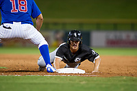AZL White Sox right fielder JJ Muno (15) slides into first base during the game against the AZL Cubs on August 13, 2017 at Sloan Park in Mesa, Arizona. AZL White Sox defeated the AZL Cubs 7-4. (Zachary Lucy/Four Seam Images)