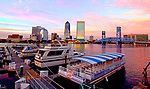 The north skyline of downtown Jacksonville Florida over the St Johns River.