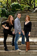 Siblings photographed on steps in Carl Schurz Park, NYC.
