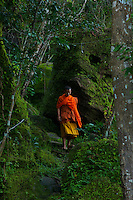 """Monk inside the Bat Cave and temple at Phnom Kulen, """"Elephant Park"""" and Bat Caves, Cambodia"""