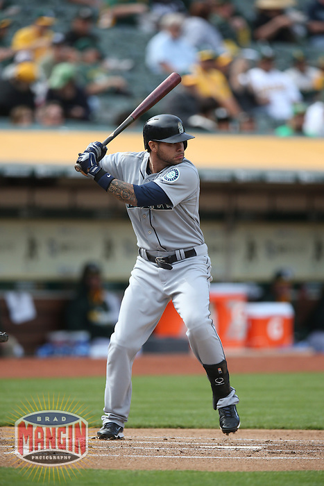 OAKLAND, CA - MAY 7:  Stefen Romero #7 of the Seattle Mariners bats against the Oakland Athletics in game two of a doubleheader at O.co Coliseum on Wednesday, May 7, 2014 in Oakland, California. Photo by Brad Mangin