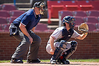 Catcher Sean Rooney #5 of the Potomac Nationals and home plate umpire Drew Ashcraft during a Carolina League game at Wake Forest Baseball Park May 10, 2009 in Winston-Salem, North Carolina. (Photo by Brian Westerholt / Four Seam Images)