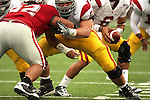 Mark Sanchez (#6), USC quarterback, takes the ball from his center, Kristofer O'Dowd (#61), during a game between the University of Southern California Trojans and the Washington State Cougars on October 18, 2008, at Martin Stadium in Pullman, Washington.  The Trojans won the game 69-0 to solidify their spot as one of the top ten college football teams in the country.