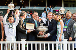 ELMONT, NY - JUNE 11:  The Creator connections, including jockey Irad Ortiz Jr., owner Bobby Flay, and trainer Steve Asmussen, hold up their trophies after winning the Belmont Stakes on Belmont Stakes Day on June 11, 2016 in Elmont, New York. (Photo by Sue Kawczynsk/Eclipse Sportswire/Getty Images)