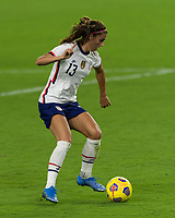 ORLANDO CITY, FL - FEBRUARY 18: Alex Morgan #13 dribbles the ball during a game between Canada and USWNT at Exploria stadium on February 18, 2021 in Orlando City, Florida.