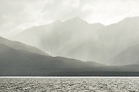 Views of moody Lake Manapouri with Kepler Mountains in background, Fiordland National Park, Southland, UNESCO World Heritage Area, New Zealand, NZ