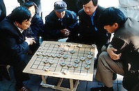 """China. Province of Beijing. Beijing. Men play in the street the traditional chinese chess game, """" majong"""".  © 2004 Didier Ruef"""