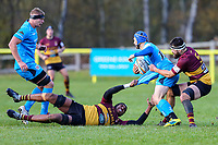Greg Dyer of Jersey Reds (2nd right) is tackled during the Greene King IPA Championship match between Ampthill RUFC and Jersey Reds at Dillingham Park, Ampthill, England on 16 November 2019. Photo by David Horn.