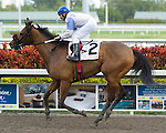 30 January 2010: Sneaking Uponyou and jockey Elvis Trujillo after the Sunshine Millions Sprint Stakes at Gulfstream Park in Hallandale Beach, FL.